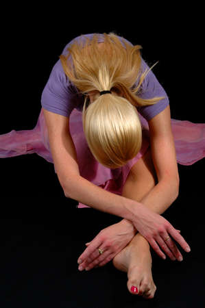 bowing: Ballerina bowing isolated over a black background