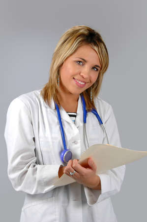 Doctor with folder and pen over a neutral background