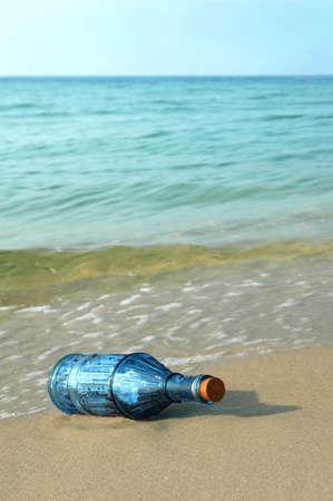 corked: Message in an old bottle on a remote shore Stock Photo