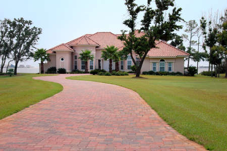 Beautiful house by the beach with brick driveway photo