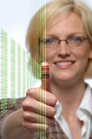 thumbprint: Woman with bar code imprinted on her thumb and laser beams
