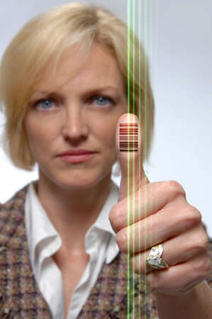 Woman with bar code imprinted on her thumb and laser beams photo