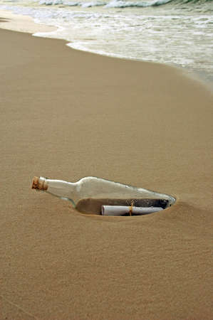 castaway: Message in a bottle washed ashore during a sunset