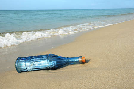 Bottle with message on a deserted shore photo