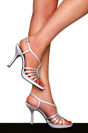 footgear: Legs with silver High Heels isolated over a white background Stock Photo