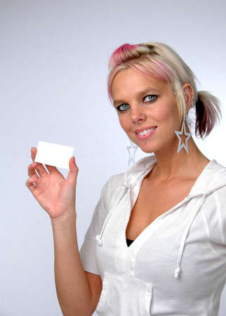 Young beautiful woman showing card. Add your own credit card or business card. photo