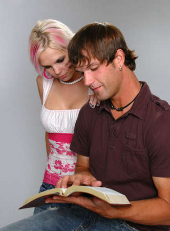Young couple reading Bible photo