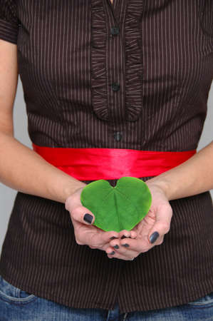 replant: Heart shaped leaf metaphor of care for the environment.