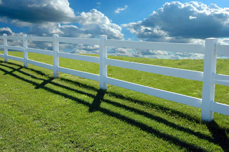 Country fence with clouds in background Stock Photo - 1788761