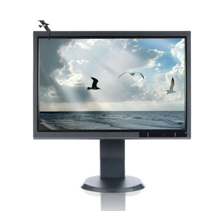 LCD monitor and seascape isolated over a white background
