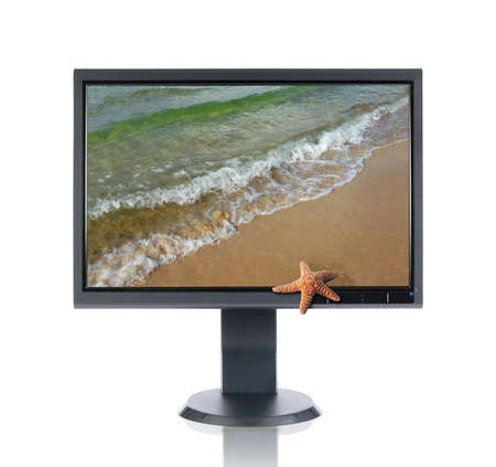 LCD monitor and starfish isolated over a white background