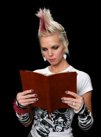 spiked hair: Punk Girl Reading Bible isolated over a black background