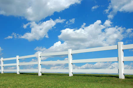 White fence against a bright sky with clouds Stock Photo - 2654832