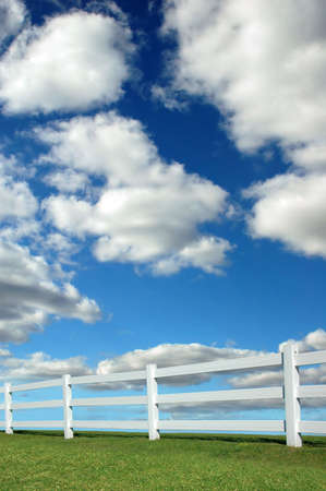 Bright landscape with white fence Stock Photo - 2654825
