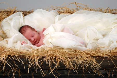 nascita di gesu: La storia di Natale con bambino Ges�, dormendo nella mangiatoia Archivio Fotografico