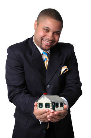 African American businessman holding a house representing home ownership. photo