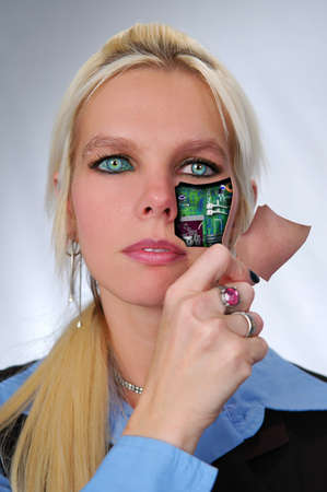 cyber girl: Bionic woman removing cover from face.