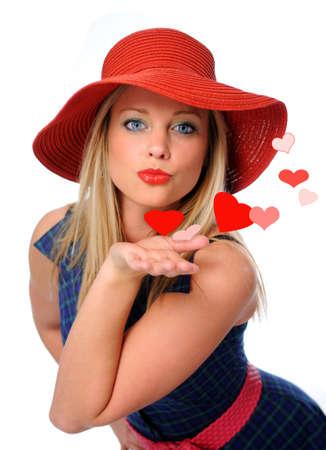 blow: baci� la giovane bella donna che soffia a suo valentines Archivio Fotografico