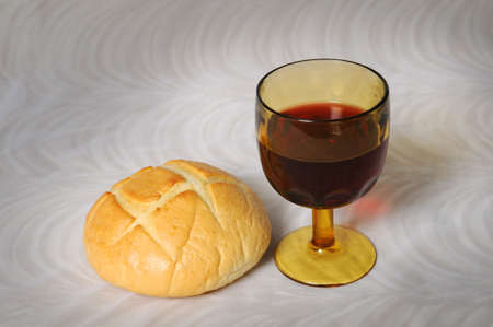 Communion simbolized by bread and wine Imagens