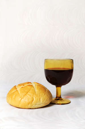 Communion elements represented by bread and wine photo