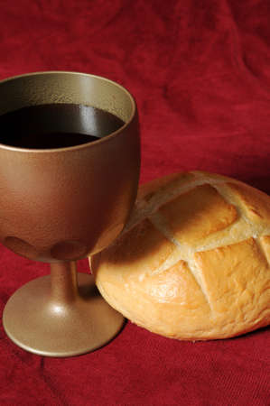 holy eucharist: Communion elements close up over a red background Stock Photo