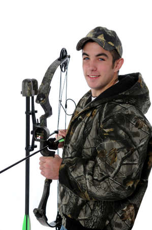 Young hunter with camo and bow and arrow isolated over a white background.