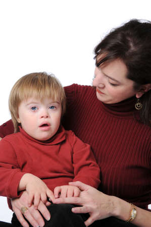 Mother and son with Down Syndrome isolated over a white background.