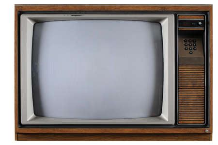 Old vintage TV with numerical buttons over a white background photo