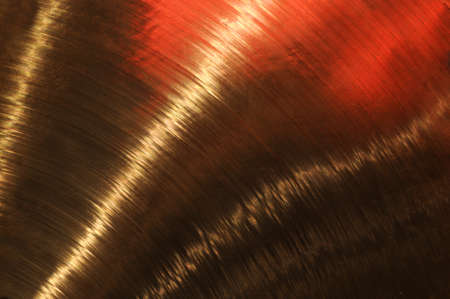 cymbal: Brass background with reflections.