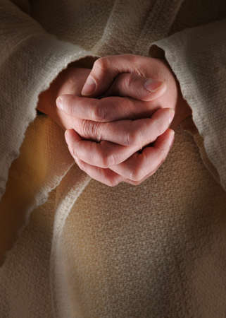 hands clasped: The hands of Jesus in clasped in prayer