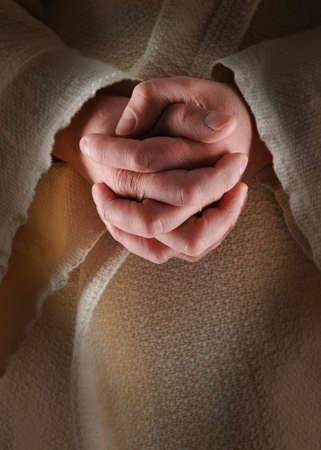 The hands of Jesus in clasped in prayer Stock Photo - 7752231