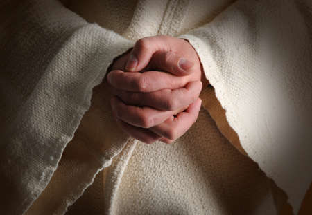 The hands of Jesus clasped in prayer photo