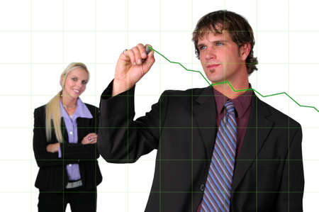 charting: Businessman charting growth with electronic pen Stock Photo