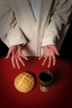 Jesus hands with scars ofering the Communion elements of bread and wine