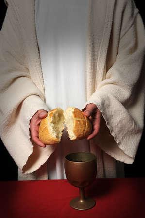 Jesus breaking bread as a symbol of Communion