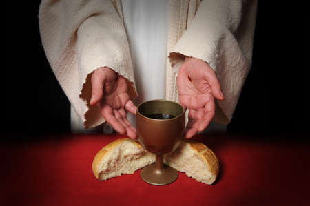 jesus christ communion: The hands of Jesus offering the Communion wine and bread Stock Photo