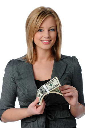 playing with money: Beautiful young woman holding a stack of money isolated over white Stock Photo