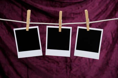 Blank Polaroid photos over a purple background photo