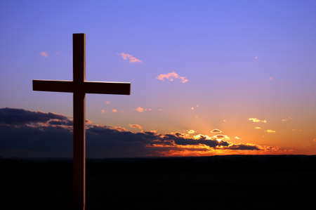 Colorful sunset with cross