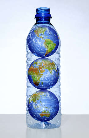 Earth with continents inside empty water bottle photo