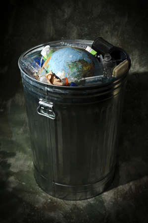 end of the world: Earth in trash can with strong directional light