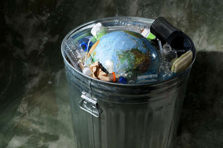Earth in a trash can with plastics and rubbish