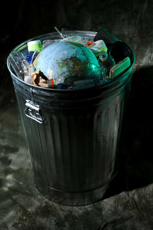 Trash can with rubish and earth and waste photo