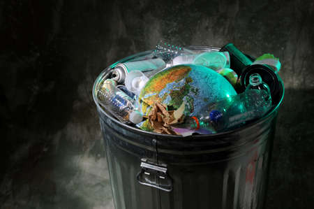 Trash can with earth and rubish photo