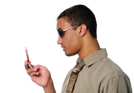 Young man dialing a cell phone Stock fotó