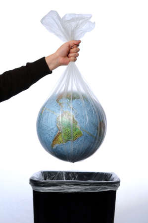 plastic: Earth in a trash bag being trown away