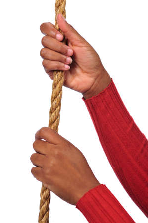 Hands of African American holding rope photo