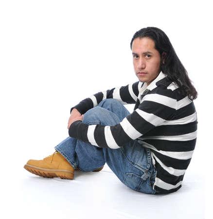 Hispanic young man sitting photo