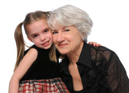 granddaughters: Grandmother and granddaughter embracing isolated over a white background