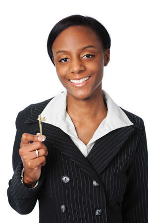 Young woman holding a key Stock Photo - 7793993